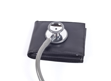 stethoscope and cash wallet on white  photo