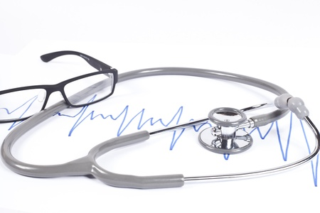 Stethoscope and blue graph on white  photo