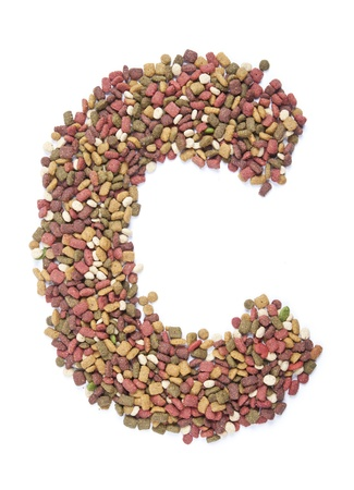 dry animal food, Letter c on white  photo