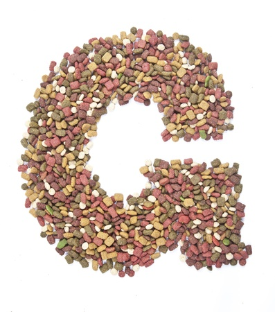dry animal food, Letter g on white  photo