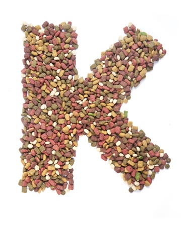dry animal food, Letter k on white  photo