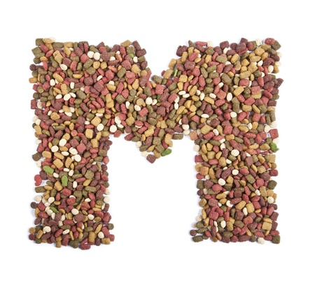 dry animal food, Letter m on white  photo
