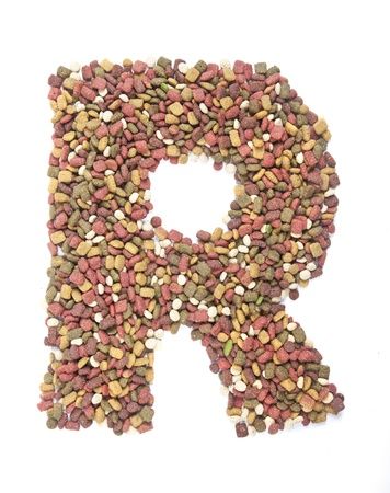 dry animal food, Letter r on white  photo