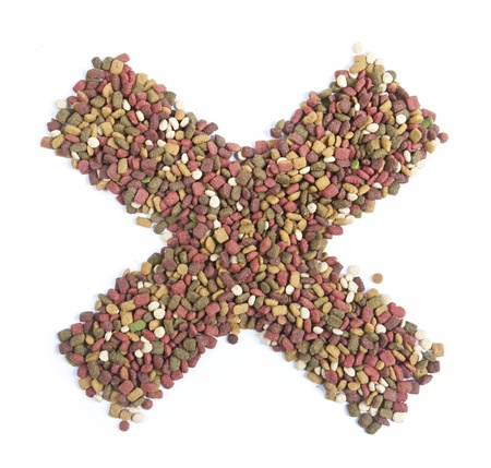 dry animal food, Letter x on white  photo