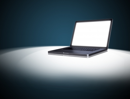 empty Laptop on dark background.  photo