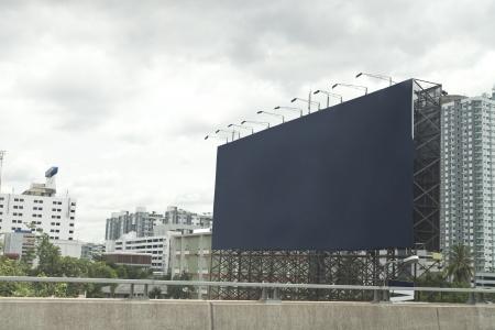 blue empty billboard on city.  photo
