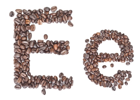 E, Alphabet from coffee beans on white background. photo