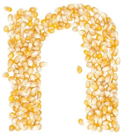 n,Alphabet from Organic corn beans dry on white  photo