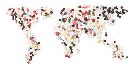 global health: world map form pills on white.  Stock Photo