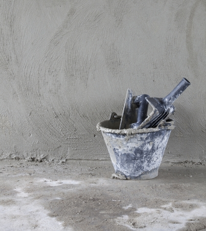 bucket and a trowel on a wall background  Stock Photo