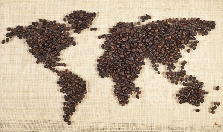 wold: wold map made of coffee beans on textured background