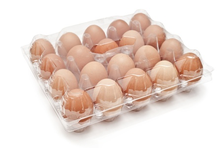 brown eggs in a carton transparent package.  photo