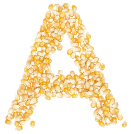 A,Alphabet from Organic corn beans dry on white  photo