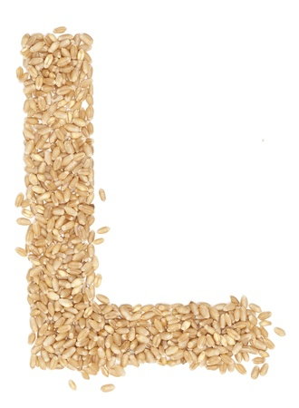 ides: L, Alphabet from dry wheat berries.  Stock Photo