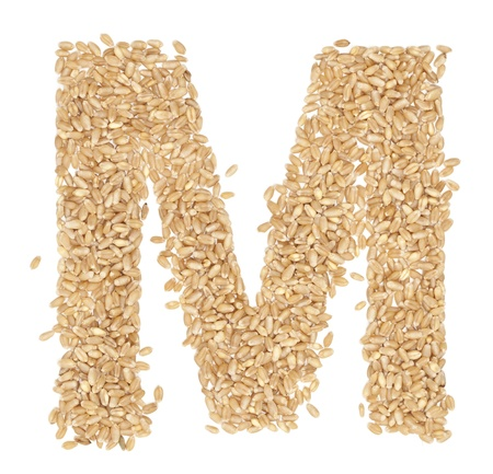 ides: M, Alphabet from dry wheat berries.  Stock Photo