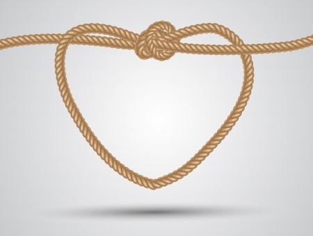 nudos: coraz�n cuerda conformada en un fondo blanco Foto de archivo