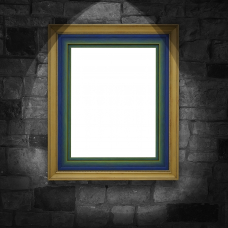 golden frame on gunge brick wall   photo