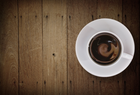 Coffee cup top view on old wooden            photo