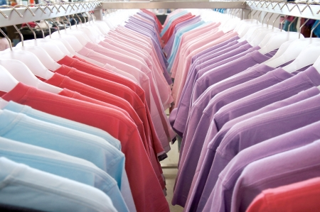 Colorful t-shirts on the hanger  Stock Photo