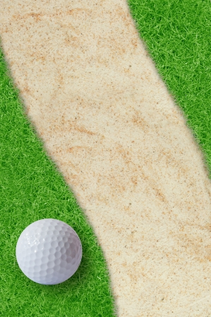 Golf ball on green grass and sand  photo