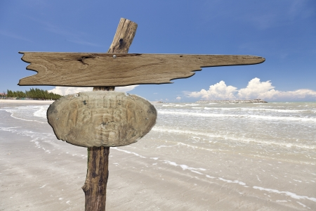 wooden signboard on tropical beach  photo