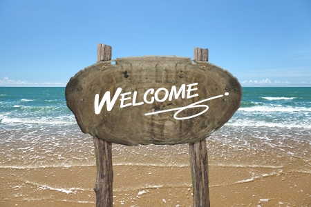 wooden signboard: WELCOME, wooden signboard on tropical beach  Stock Photo