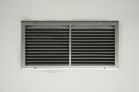 Ventilation on a wall of an industrial building photo