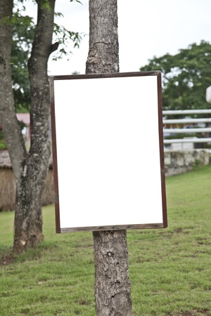 empty wooden sign post on  garden photo