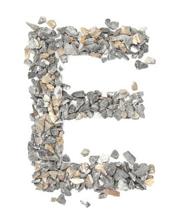 e alphabet: E - alphabet made form stone on white.