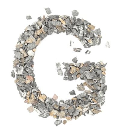g alphabet: G - alphabet made form stone on white.