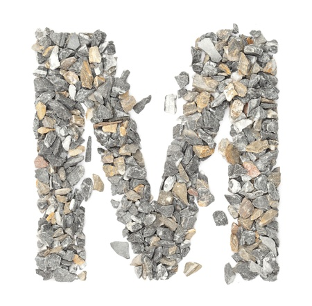 M - alphabet made form stone on white.  photo