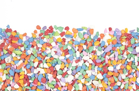 colorful gravel on white background.