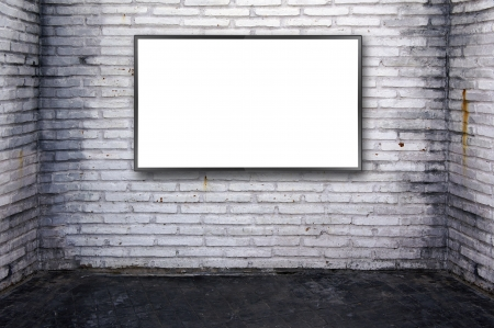 Blank modern flat screen at grunge brick wall background.  photo