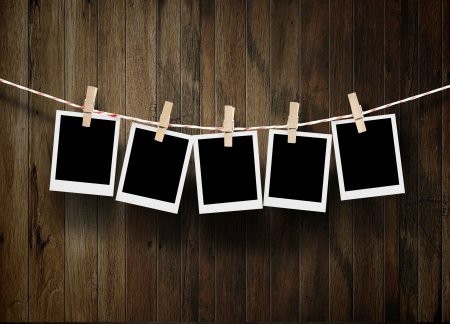 clothes pin: empty photos frames on wood