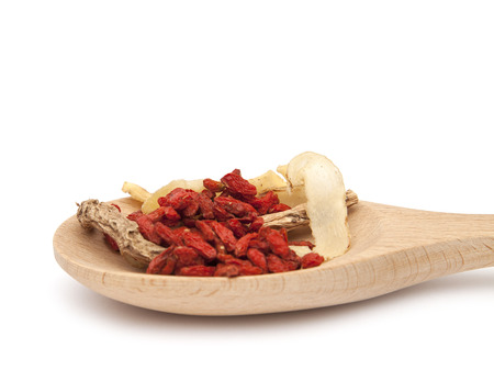 Chinese traditional herbs in spoon on white