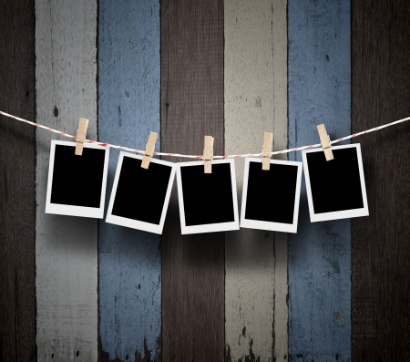 clothes pins: empty photos frames on wood