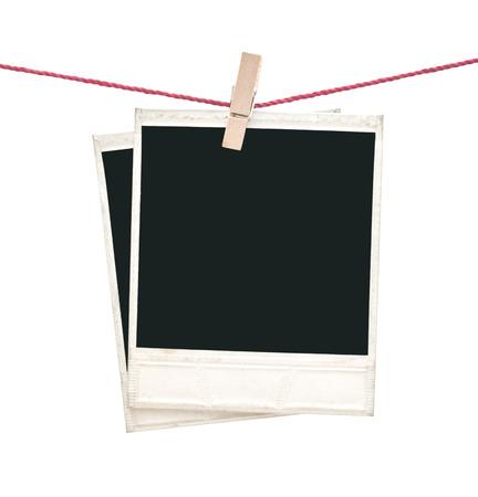 two polaroid photos hanging isolated on white  Stock Photo