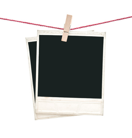 two polaroid photos hanging isolated on white  photo