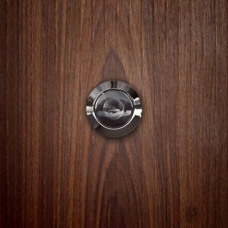 peephole: door lens peephole on lwooden.  Stock Photo