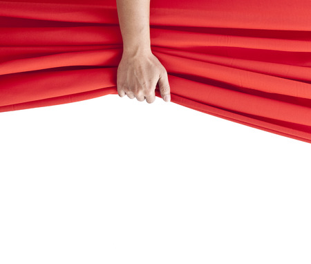 hand opening red curtain on white. Stock Photo