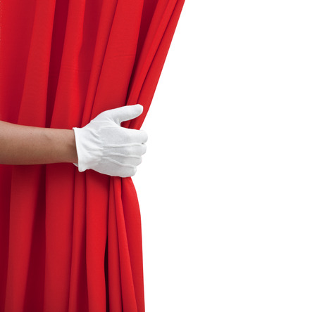 red curtain: hand opening red curtain on white. Stock Photo