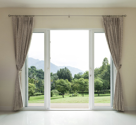 curtain window: Opened door,  green garden view