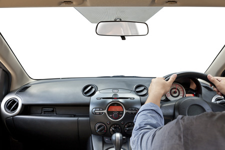Hands on the steering wheel isolated on a white  photo