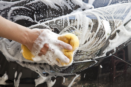 Washing a car with a sponge and soap  photo