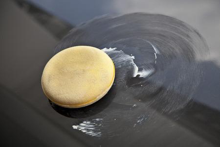 polish wax op de auto Stockfoto