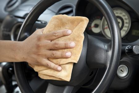 microfiber: hand with microfiber cloth polishing steering wheel