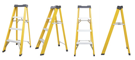ladder safety: set of yellow Ladder  isolated on white Stock Photo