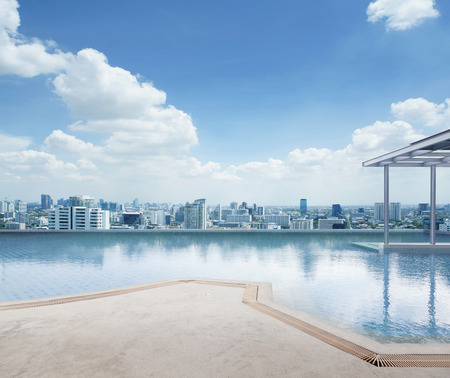 View of swimming pool at cityscape.