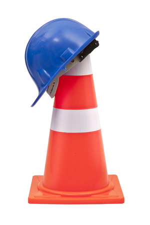 Blue Helmet and Traffic cone  Isolated on white photo