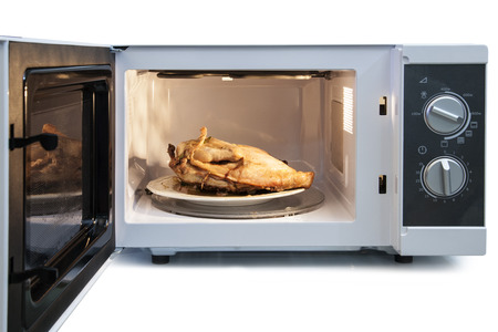 Appetizing roast chicken in the oven  photo